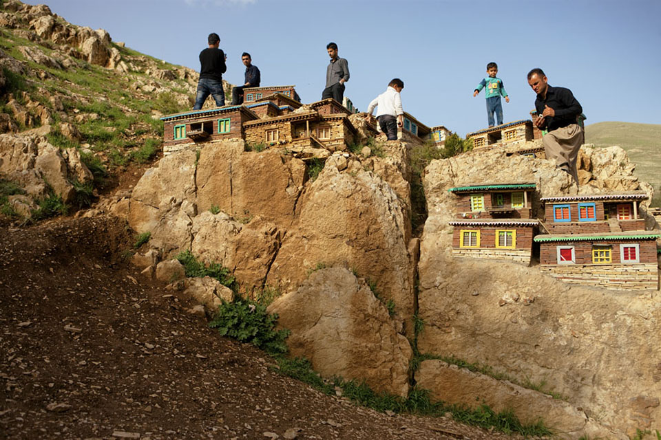 Tourists atop a miniature village in Sulaimani. The Kurds are a traditional mountain people, with more than 30 million of them spread throughout Iran, Iraq, Turkey, Syria, and Central Asia.