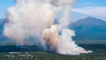 A brush fire burns in South Anchorage, Alaska