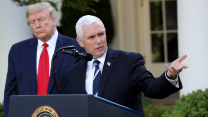 President Trump stands behind Vice President Pence at a podium outdoors in the White House Rose Garden.