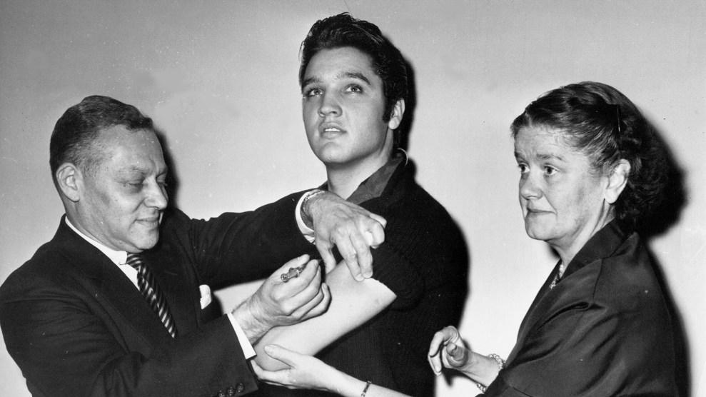 Elvis Presley receives the polio vaccine