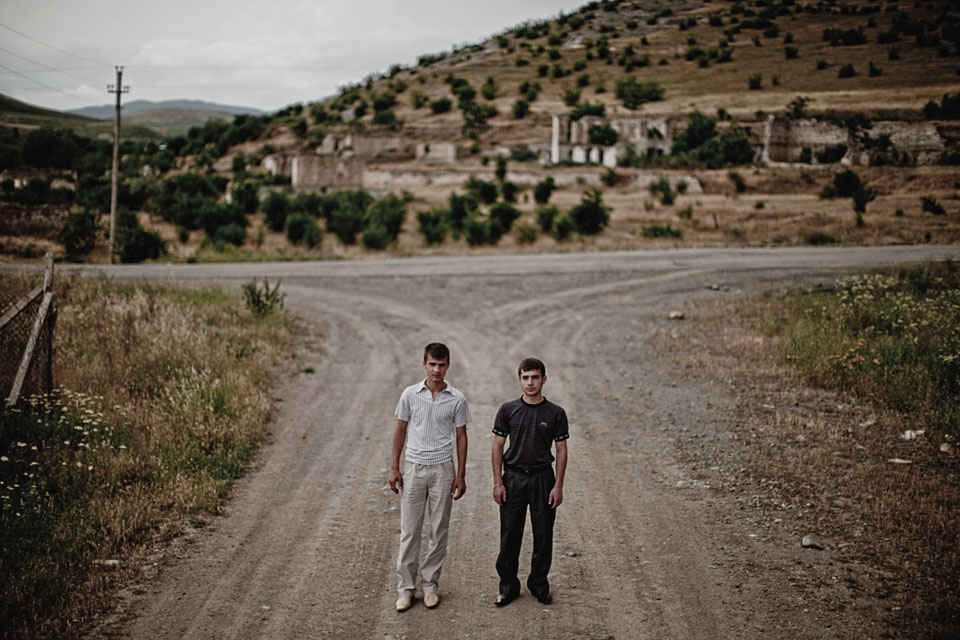 Future: Mardakert, 2009. Nikolai Hayrapetyan, 18 years old, and Vahag Hayrapetyan, 17. Their father, Garegin, was killed at age 31 on this crossroad.