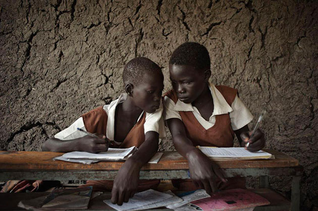 Students in a village school in Owachi, located next to the Nile, in the Upper Nile State. Women's literacy in South Sudan stands at 16 percent, and a 15-year-old girl has a greater chance of dying in childbirth than completing her education.